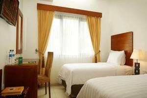 Assalam Syariah Hotel Solo Solo - Kamar tamu