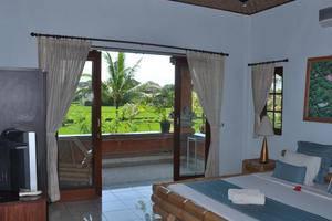 Uma Sari Cottage Bali - Kamar Deluxe