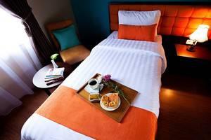 Ole Suites Hotel Bogor - Kamar yang cerah dipadu dengan lembutnya selimut serta kasur yang ergonomis