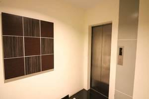 NIDA Rooms Grand Ance Makassar - Mengangkat