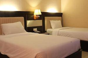 Hotel Zahra Kendari - Kamar tidur