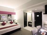 Grand Darmo Suite Surabaya - Deluxe Suite dengan Sarapan  LAST MINUTE DEALS WEEKEND