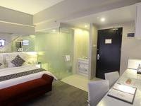 Grand Darmo Suite Surabaya - Deluxe Suite Room Only  Same Day Deal 61%