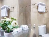 Safirna Transito Hotel Ternate - Deluxe Twin Room Regular Plan