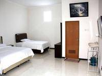 Baliku Guest House Batu - Deluxe Triple Regular Plan