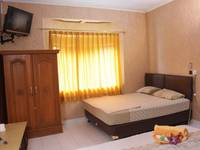 Orange Home Bandung - Standard Quad Room with Breakfast Regular Plan