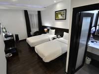 Continent Centrepoint Panakkukang - Deluxe Twin Room Regular Plan